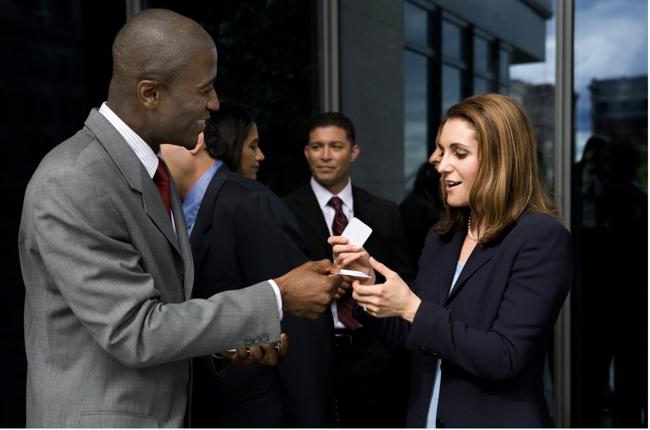 Exchanging business cards at a networking event
