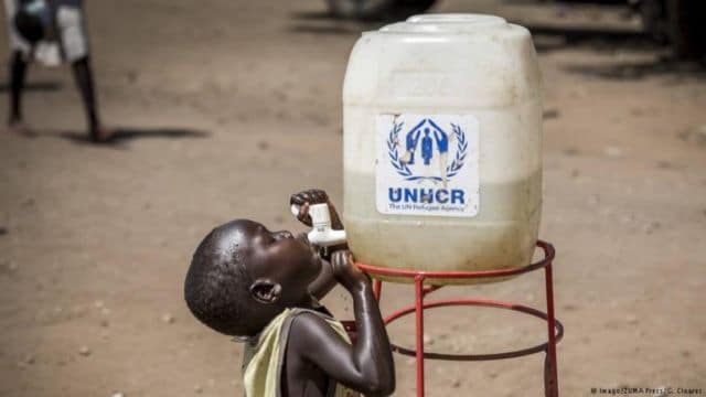 Child drinking from a UNHCR water tap